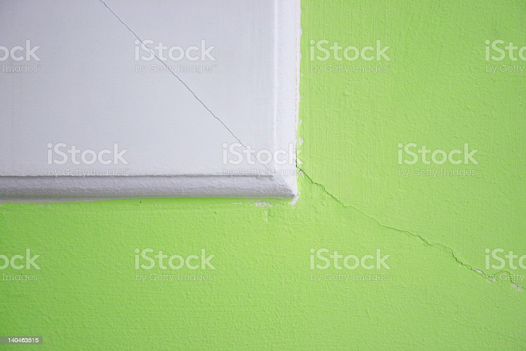 Painting Crack in the green wall royalty-free stock photo