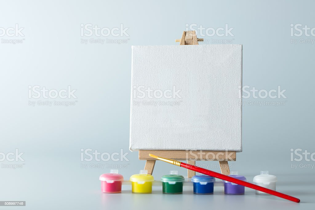 Painting easel with empty canvas stock photo