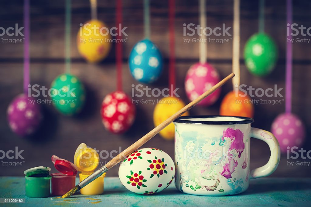 Painting Easter eggs and hanging colorful eggs stock photo