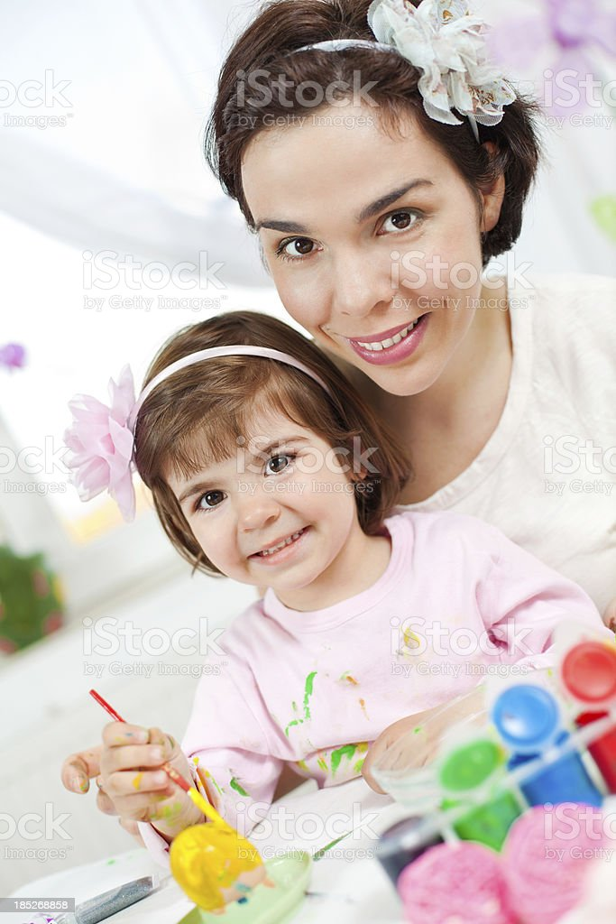 Painting Easter eggs is fun! royalty-free stock photo