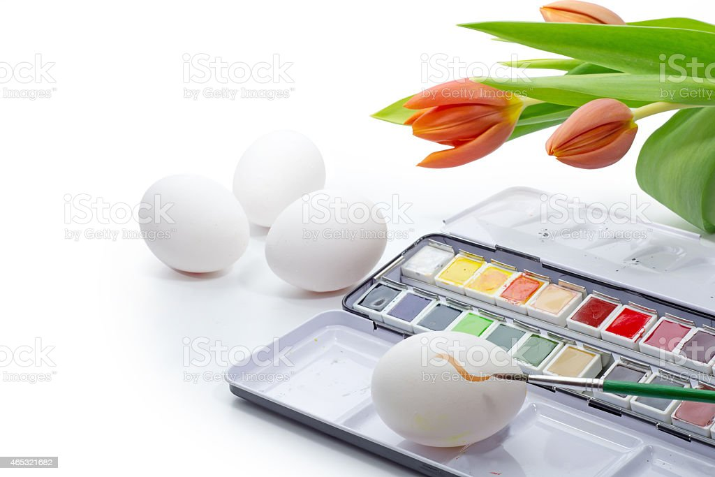 painting Easter eggs with watercolor isolated on white stock photo