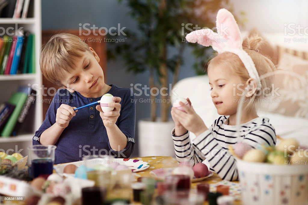 Painting eggs before the Easter is a tradition stock photo