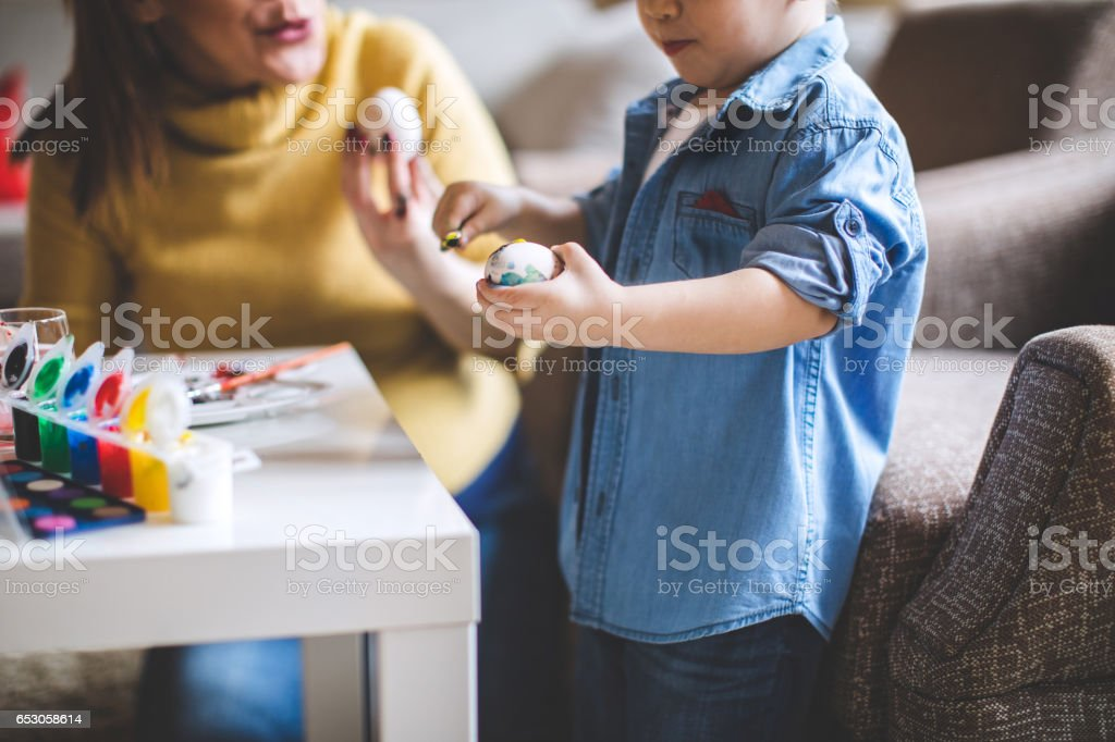 Painting eggs with mom stock photo
