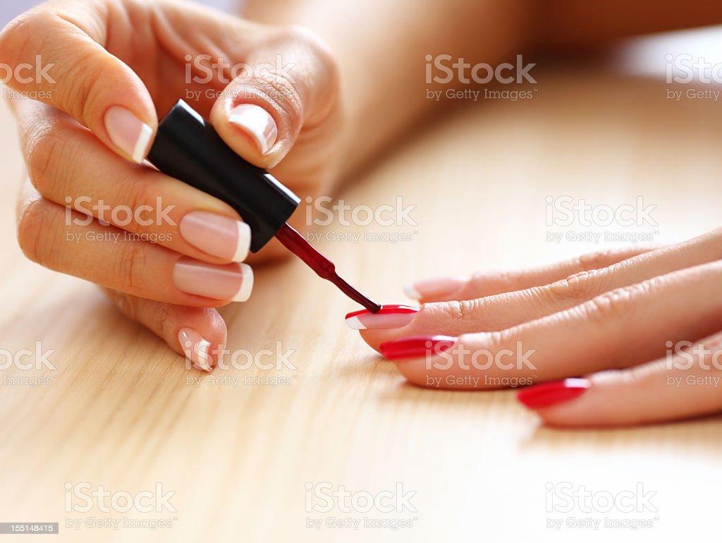 Painting fingernails stock photo