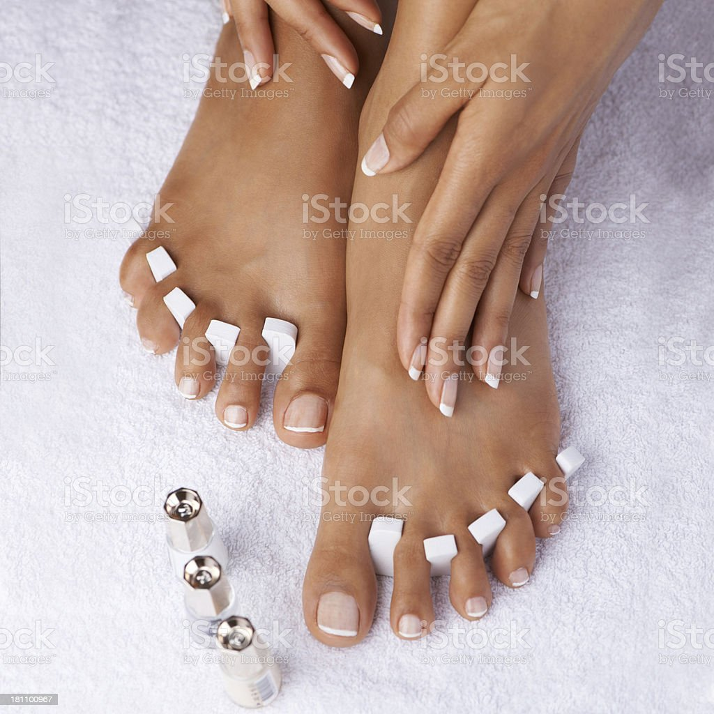 Painting her toenails before taking on the town royalty-free stock photo