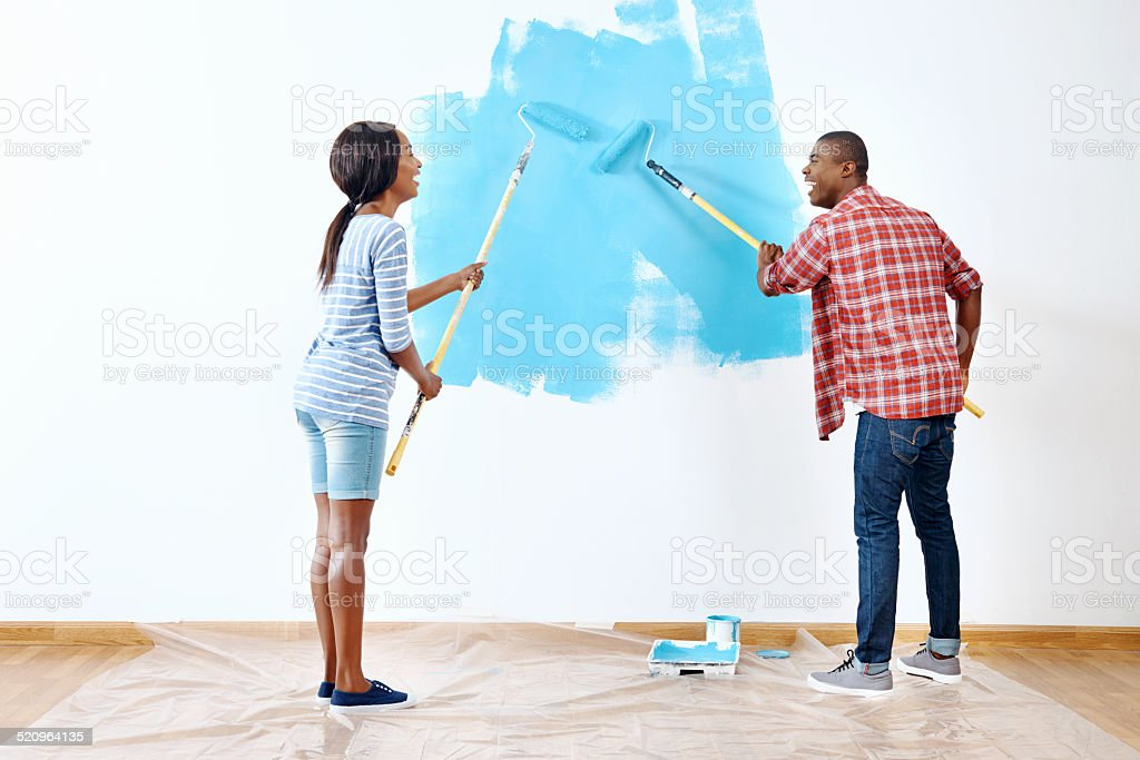 painting house couple stock photo