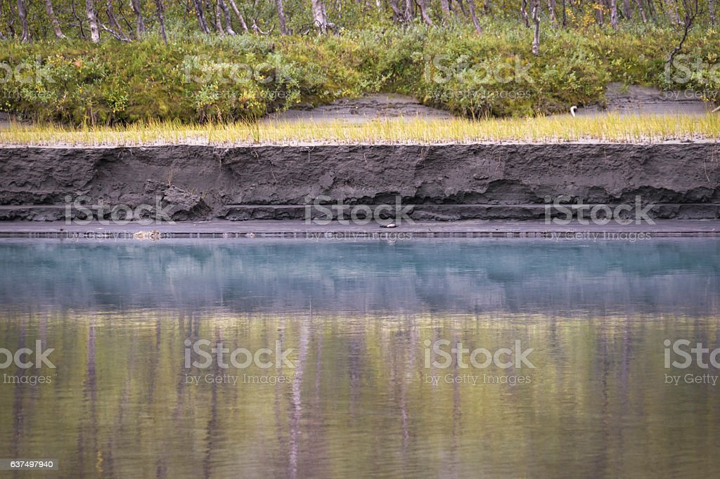Painting like reflection in blue river water with beautiful textured stock photo