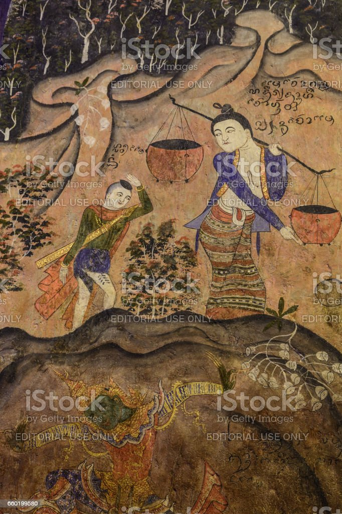 Painting murals People living in northern Thailand ancient times. stock photo