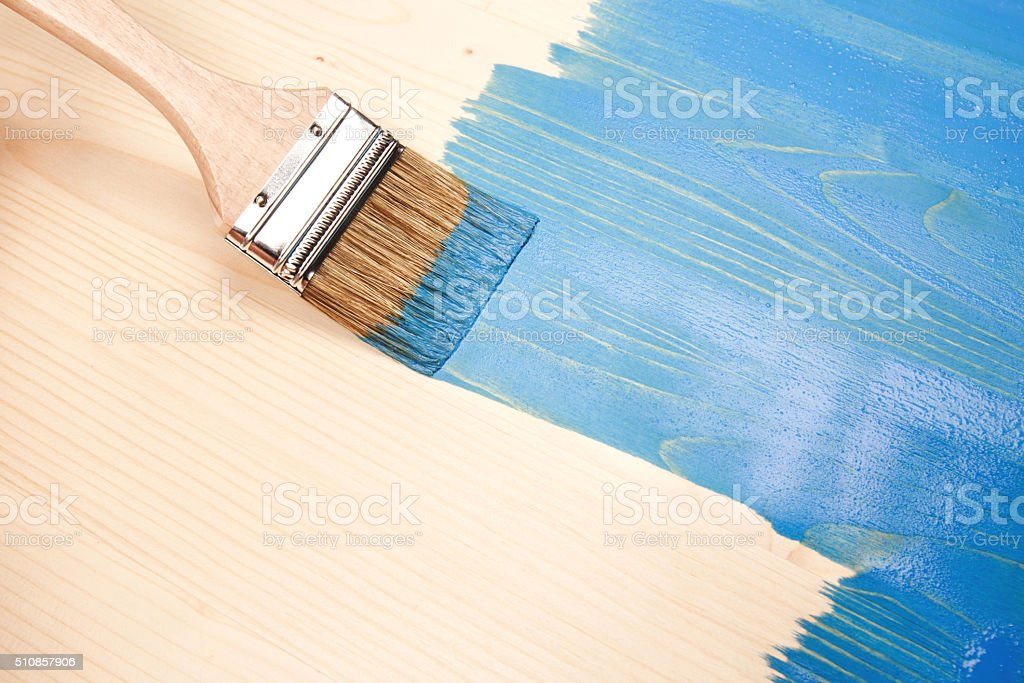 Painting natural wood in blue stock photo