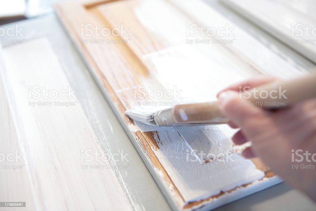 Painting Oak Kitchen Cabinets royalty-free stock photo