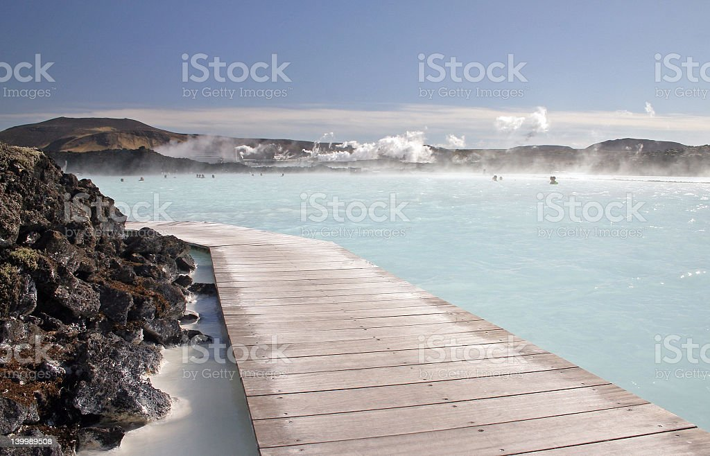Painting of a blue lagoon on a gloomy day royalty-free stock photo