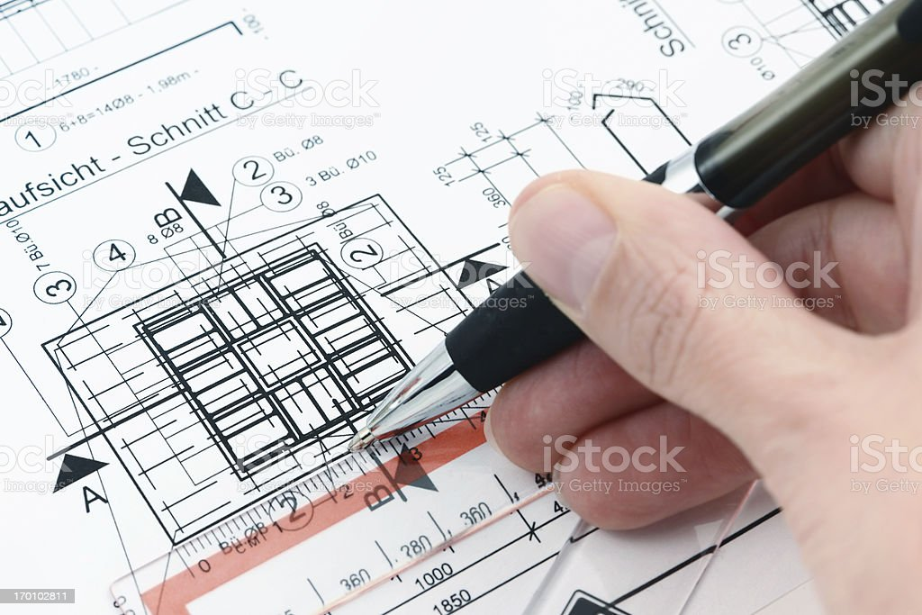 painting on a blueprint plan of house building royalty-free stock photo