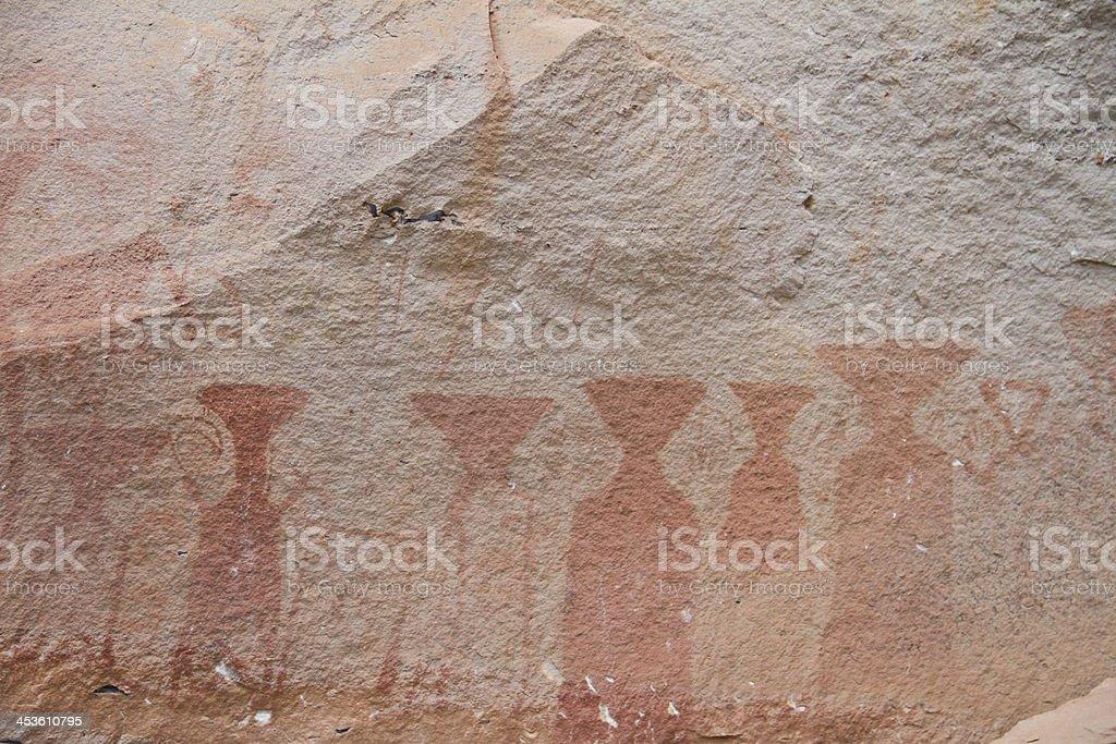 Painting on stone wall at Patam Ubonratchathani Province, Thailand royalty-free stock photo