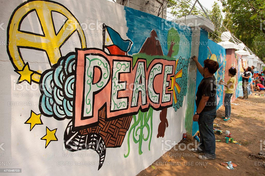 Painting peace in a wall stock photo