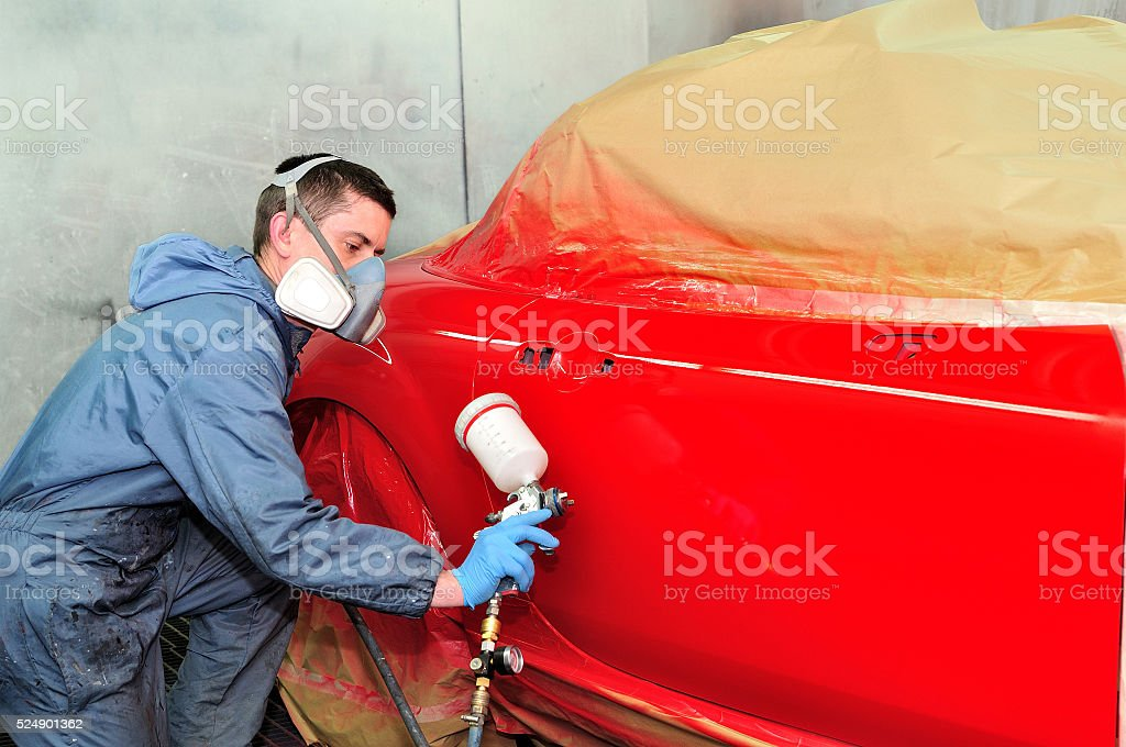 Painting red car. stock photo