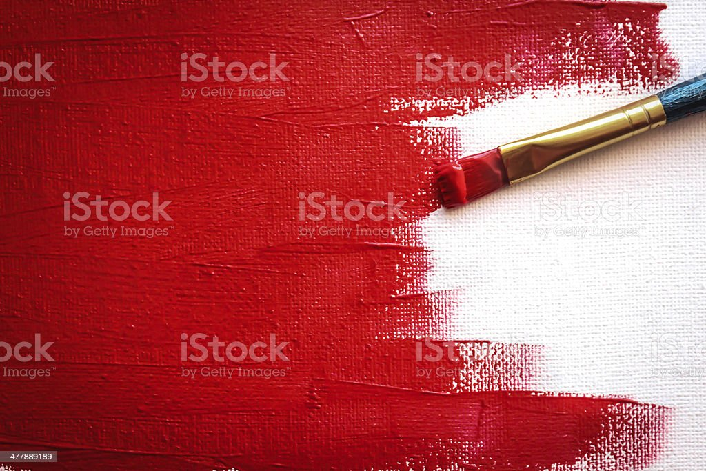 Painting  red with a paint brush stock photo