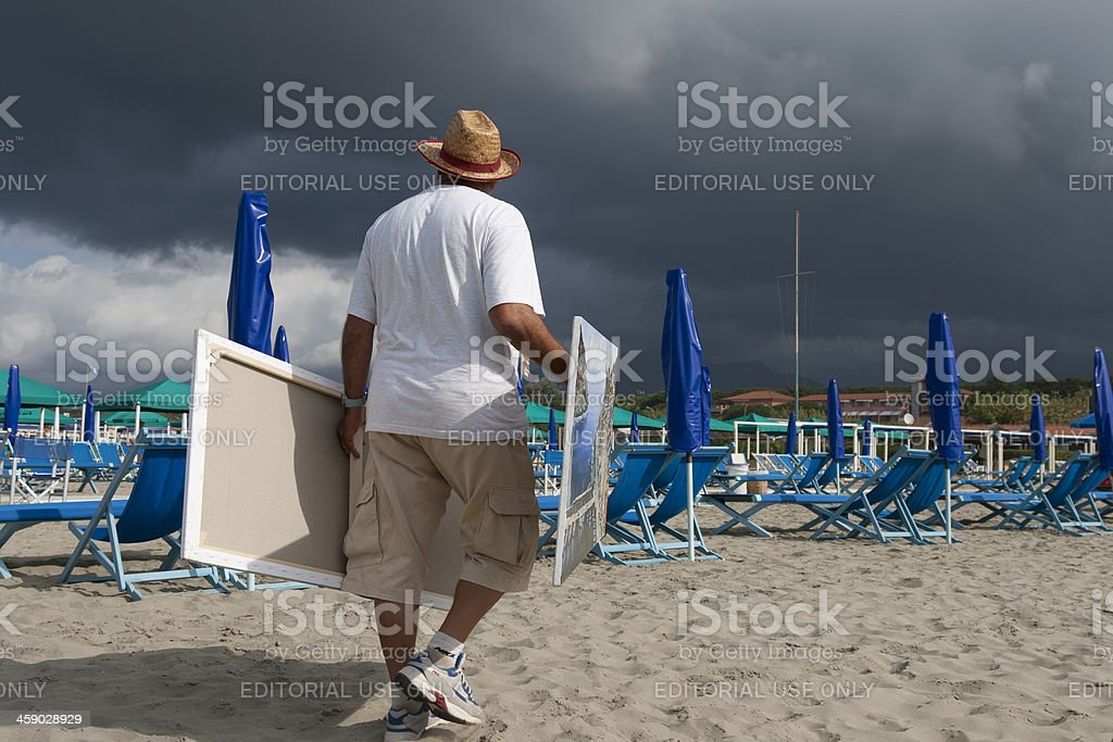 Painting seller on the beach royalty-free stock photo