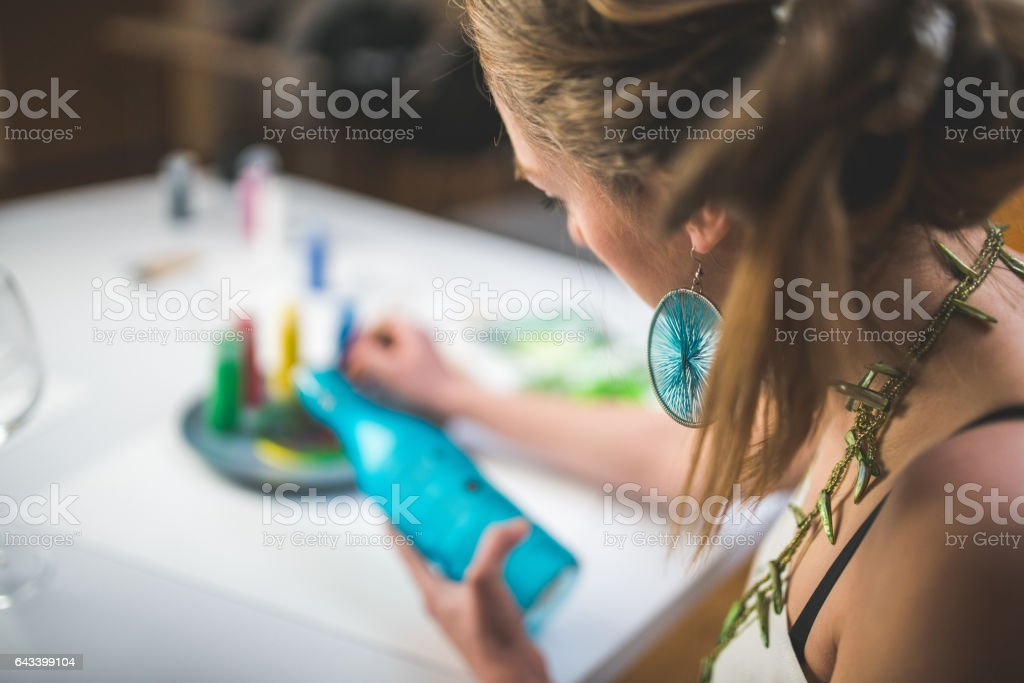 Painting the bottle stock photo