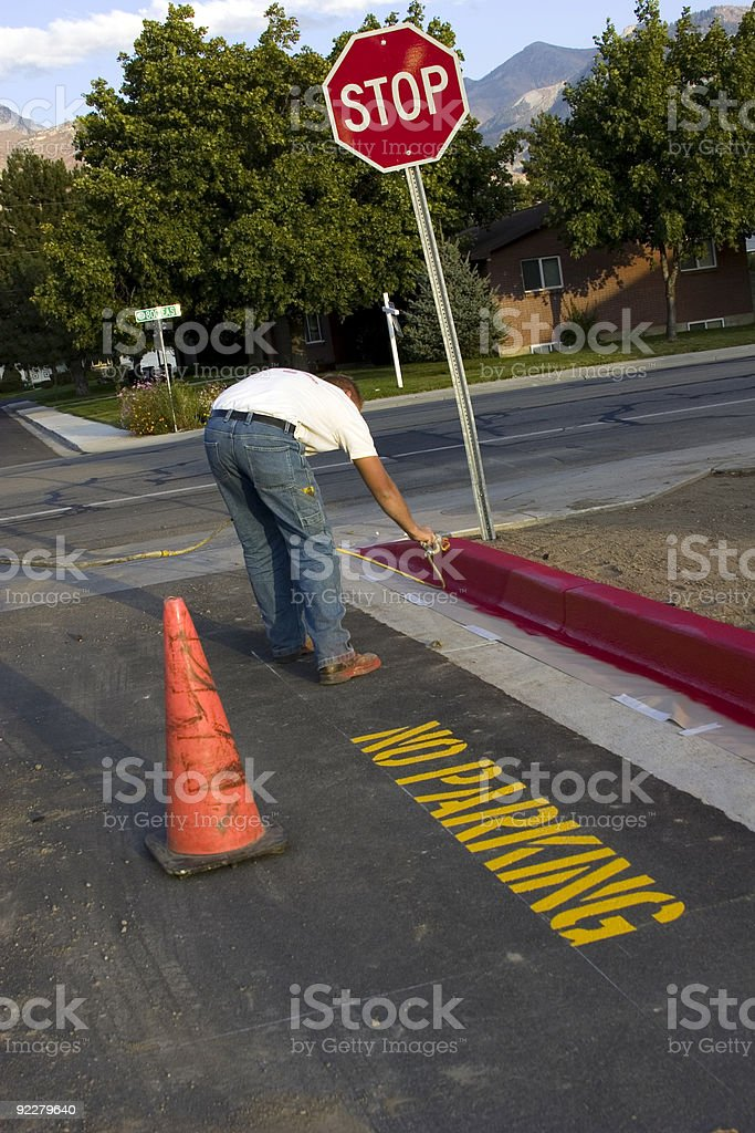 Painting the Curb Red. No Parking royalty-free stock photo