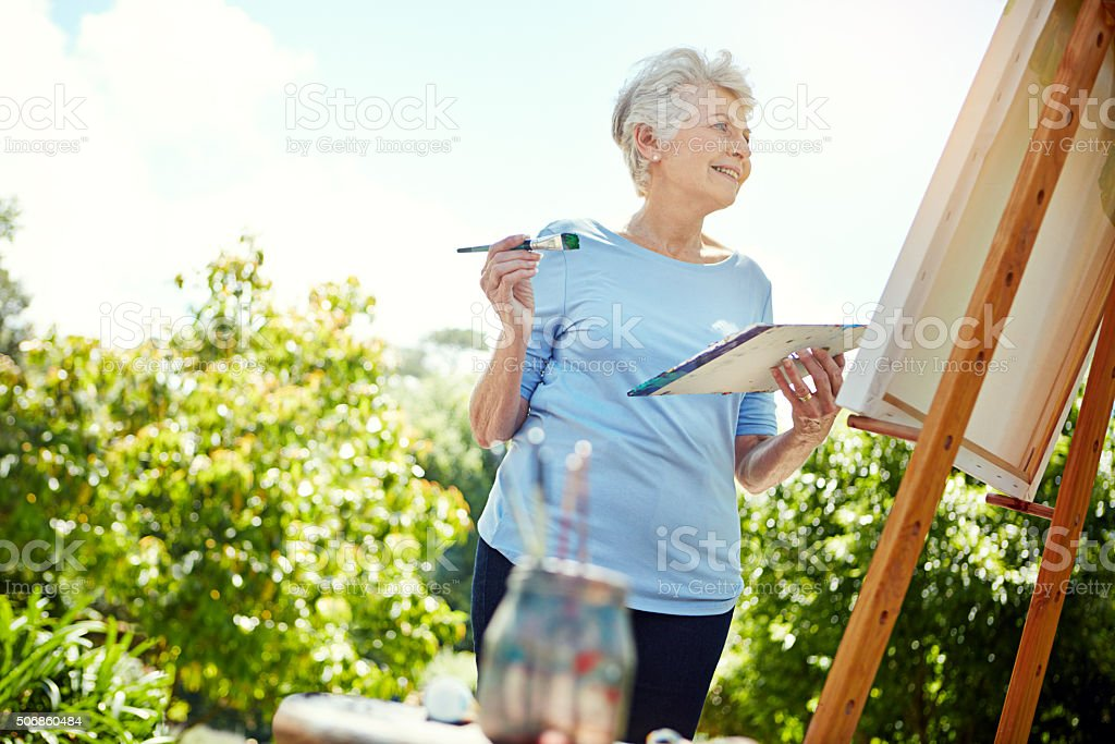 Painting the day away stock photo