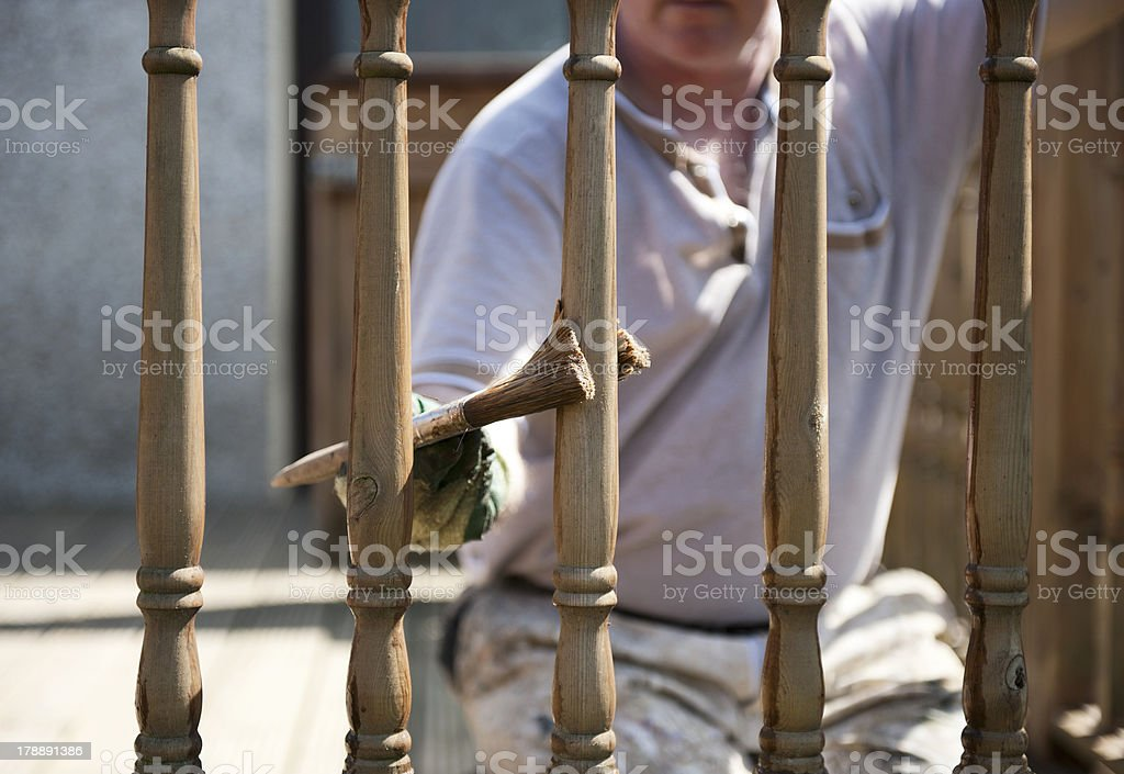 Painting the fence stock photo