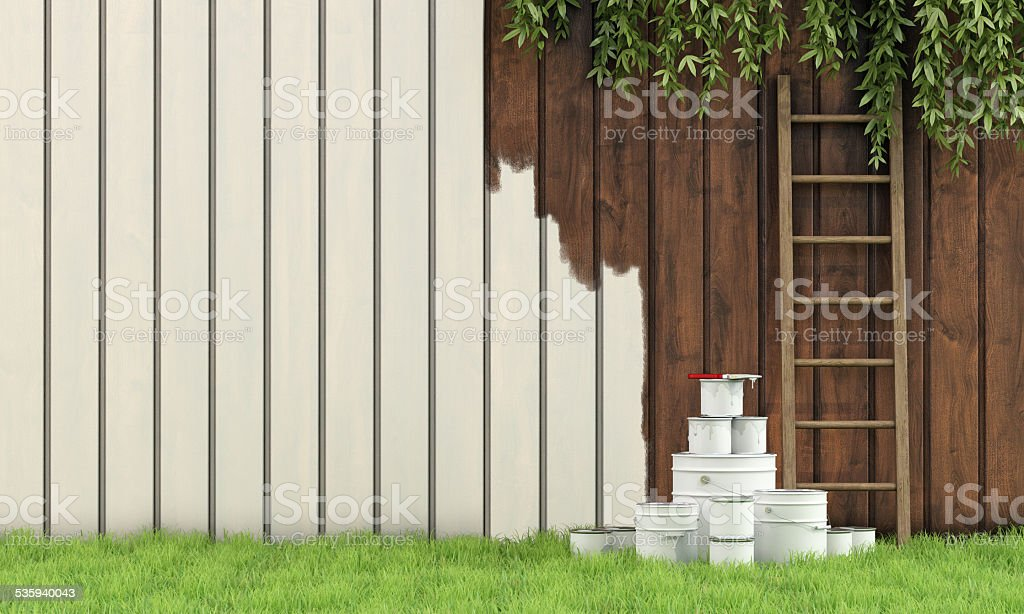 Painting the garden fence stock photo