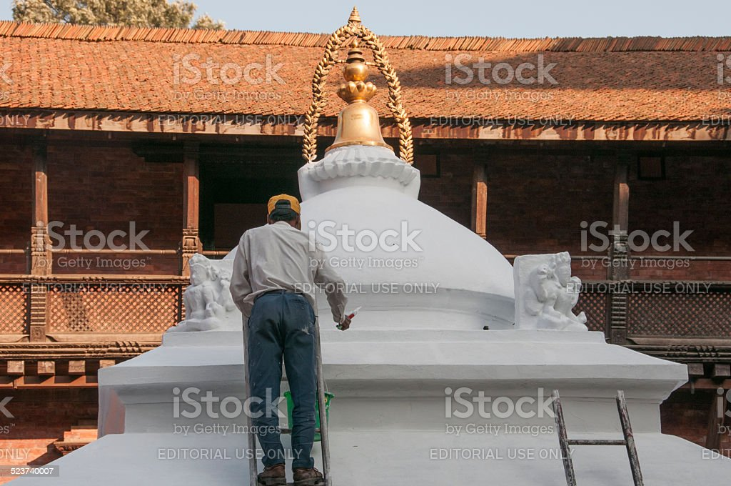 Painting the stupa stock photo