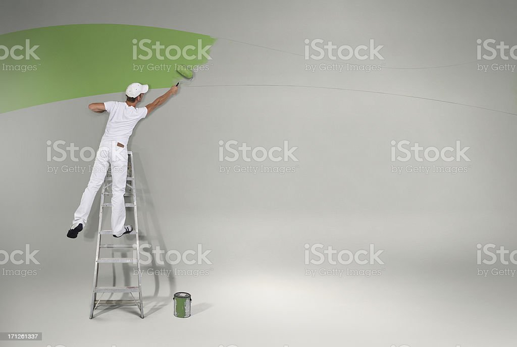 Painting the wall green again stock photo