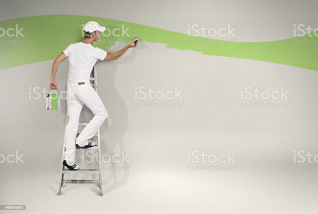 Painting the wall green stock photo