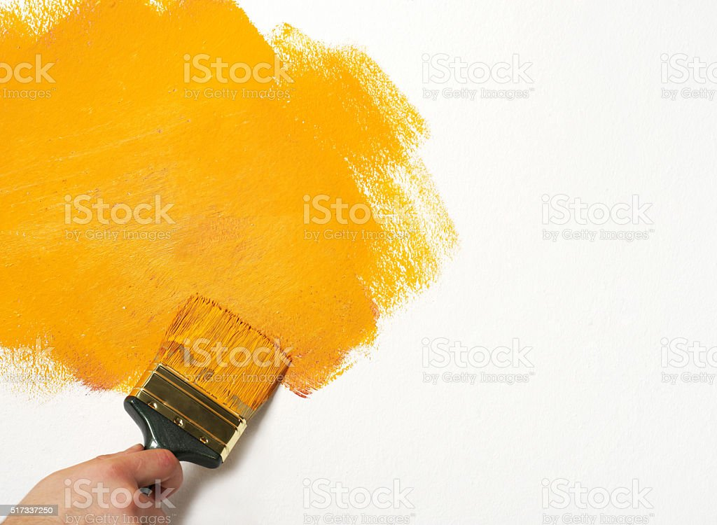 Painting the wall stock photo