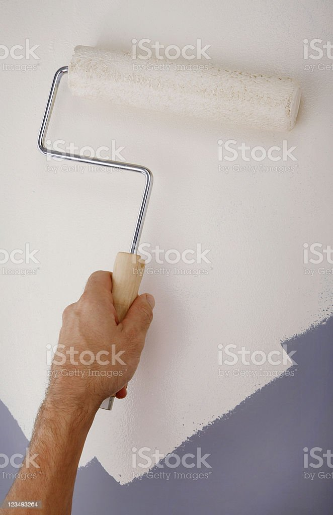 painting the wall with a roller royalty-free stock photo
