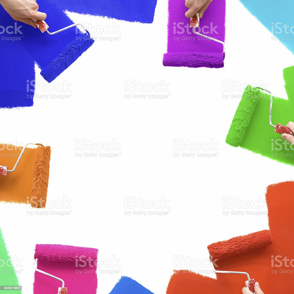 Painting the wall with colorful rollers royalty-free stock photo