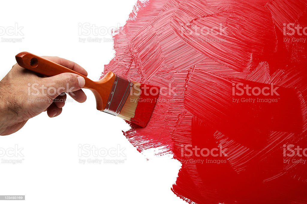 painting the wall with red paint stock photo