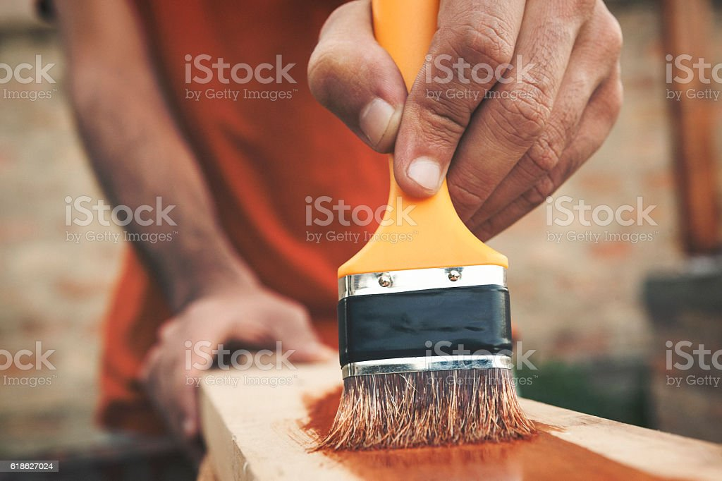 Painting the wooden board close up shot stock photo