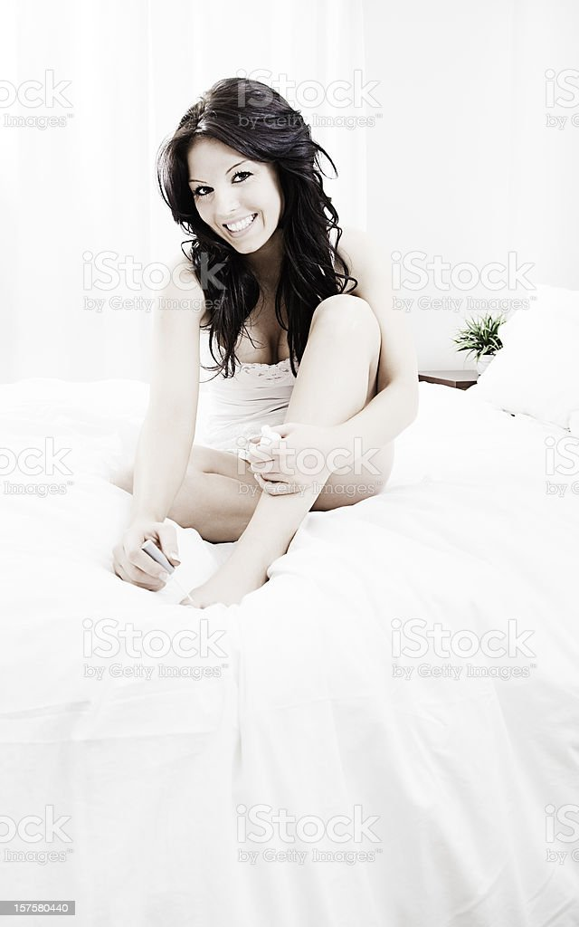 Painting Toes in Bed royalty-free stock photo