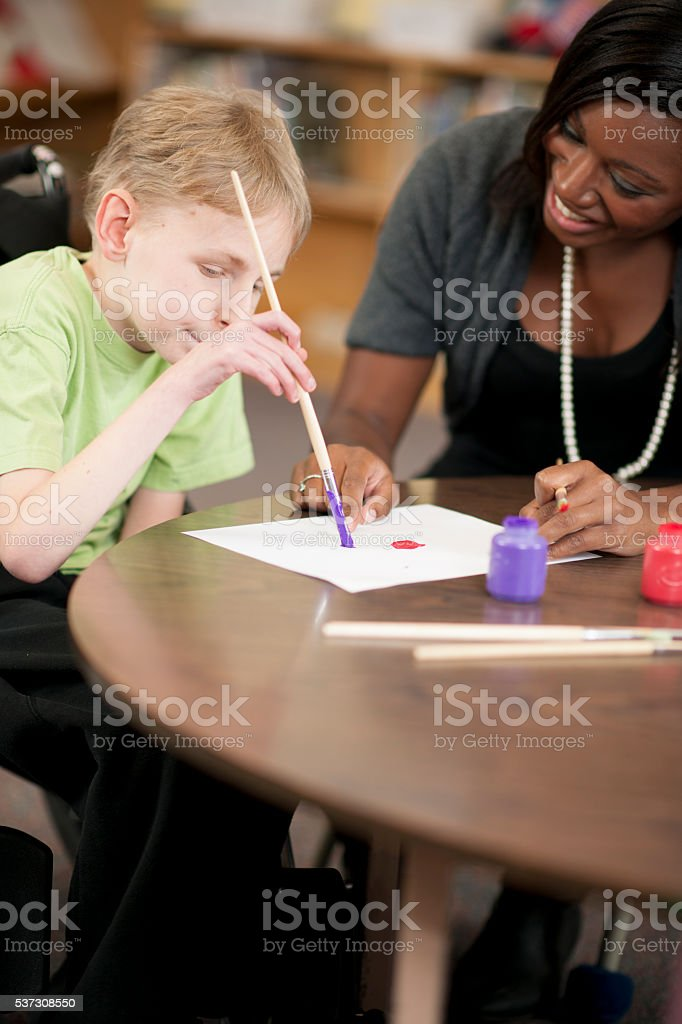 Painting Together in Homschool stock photo
