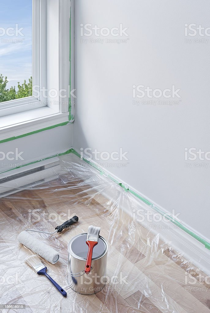 Painting tools on covered floor with plastic royalty-free stock photo