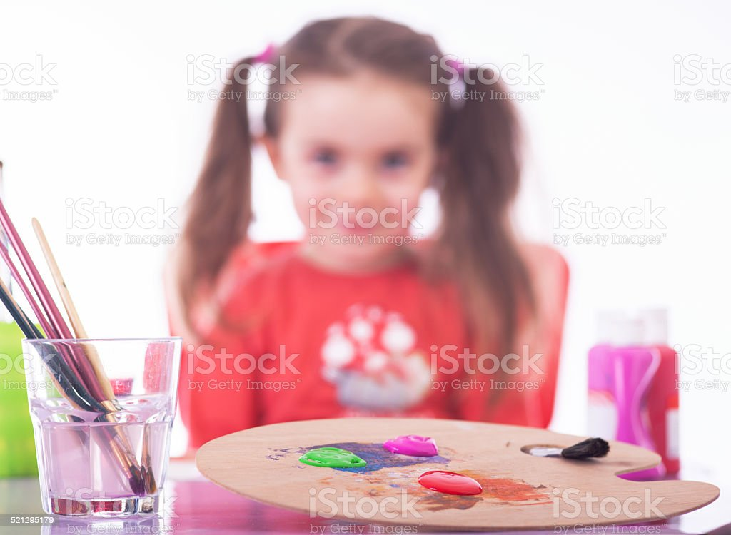 Painting Utensils with Girl in the Background stock photo