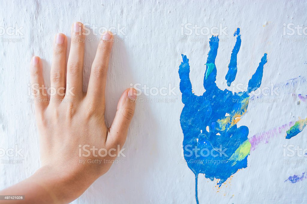 Painting wall with hands stock photo
