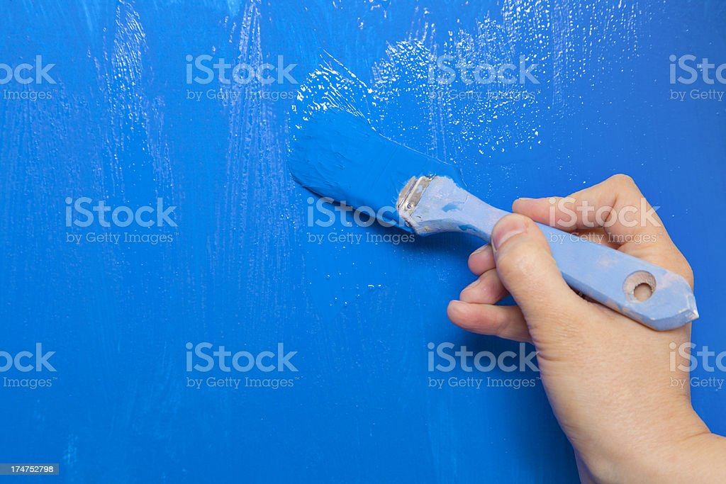 Painting wall with paintbrush royalty-free stock photo