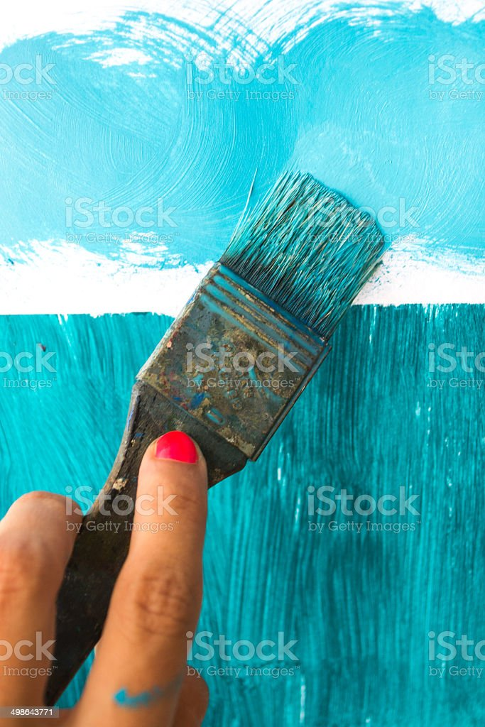Painting with brush stock photo