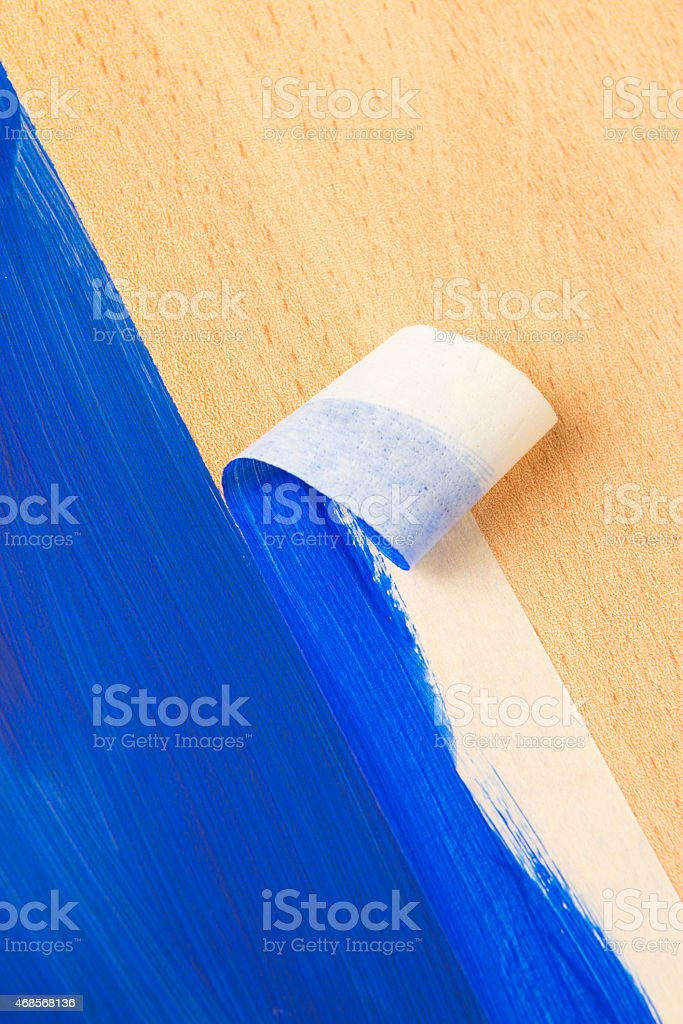 Painting with masking tape stock photo