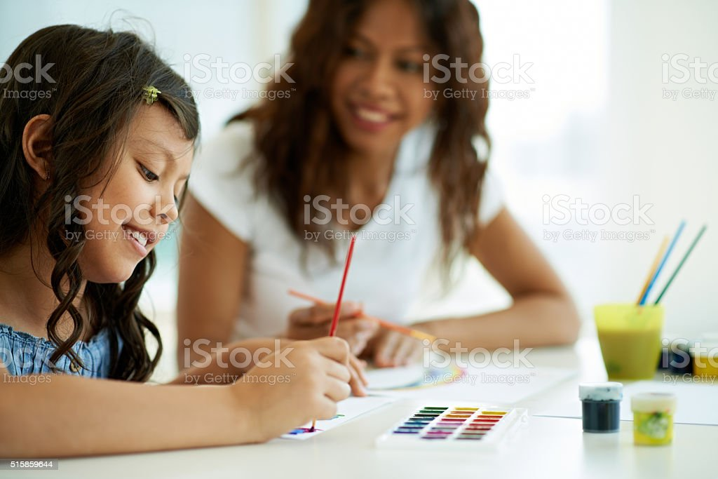 Painting with mother stock photo