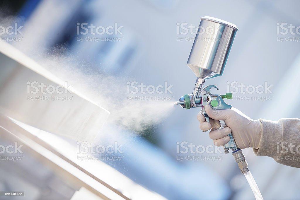 Painting with spray gun stock photo
