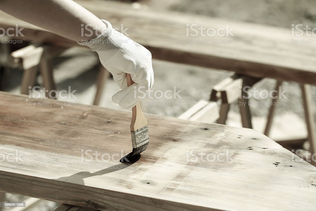 Painting wood with wood protection paint stock photo