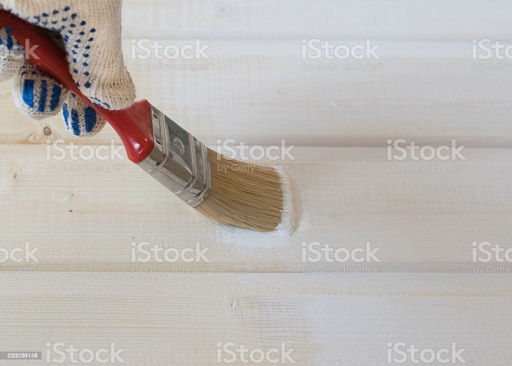 painting wooden lining of pine stock photo