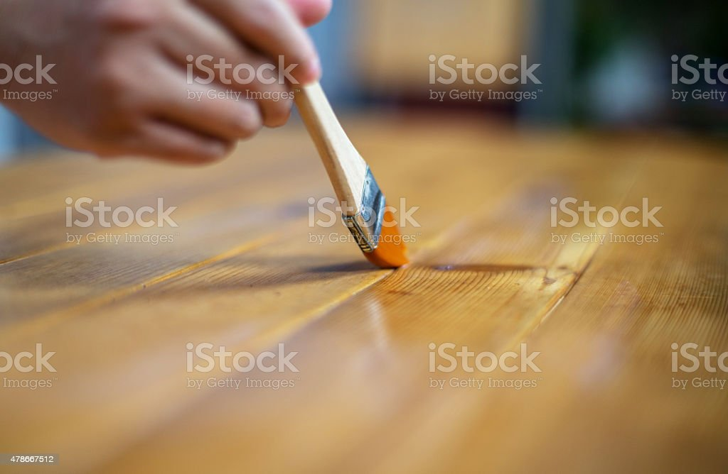 painting wooden table with brush stock photo