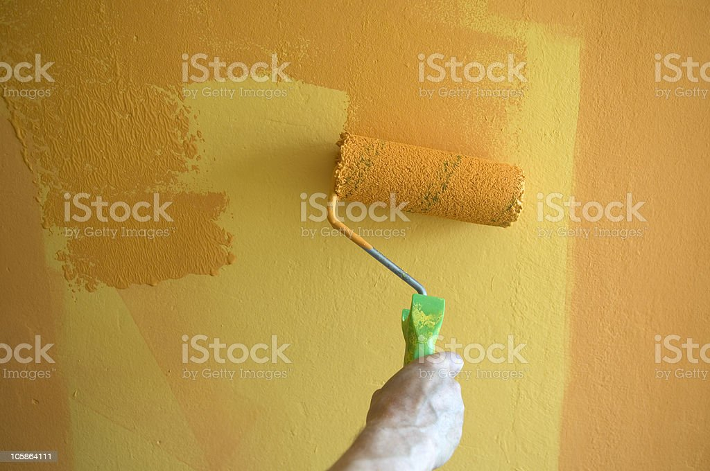 Painting Yellow Wall in Orange royalty-free stock photo