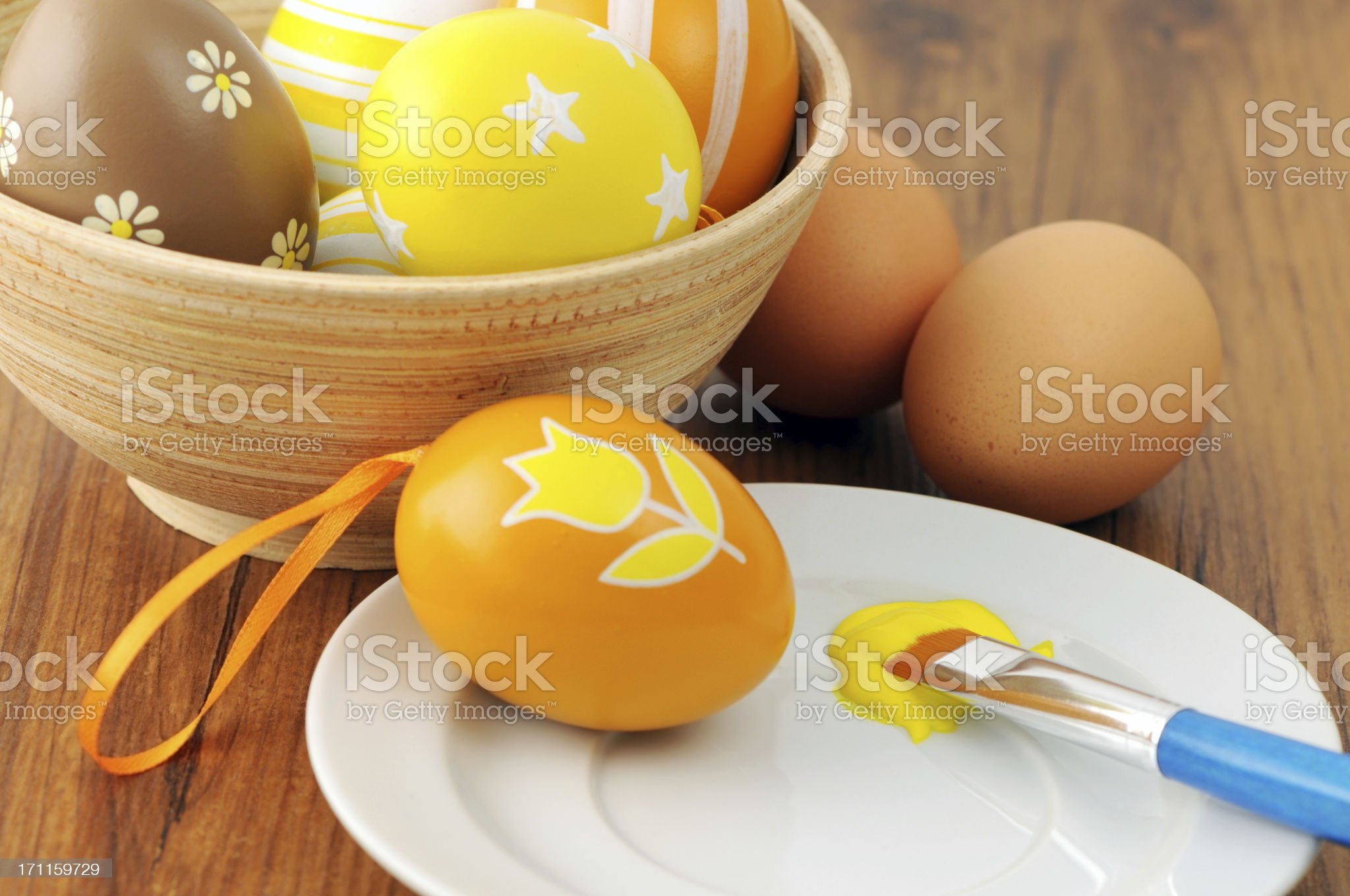 Paintingornate on organg and yellow Easter egg royalty-free stock photo
