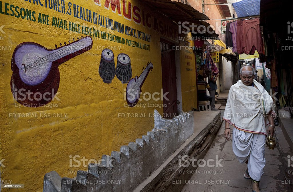 Paintings on wall in old streets of Varanasi stock photo